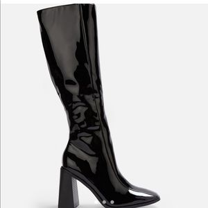 knee high heeled black pvc boots